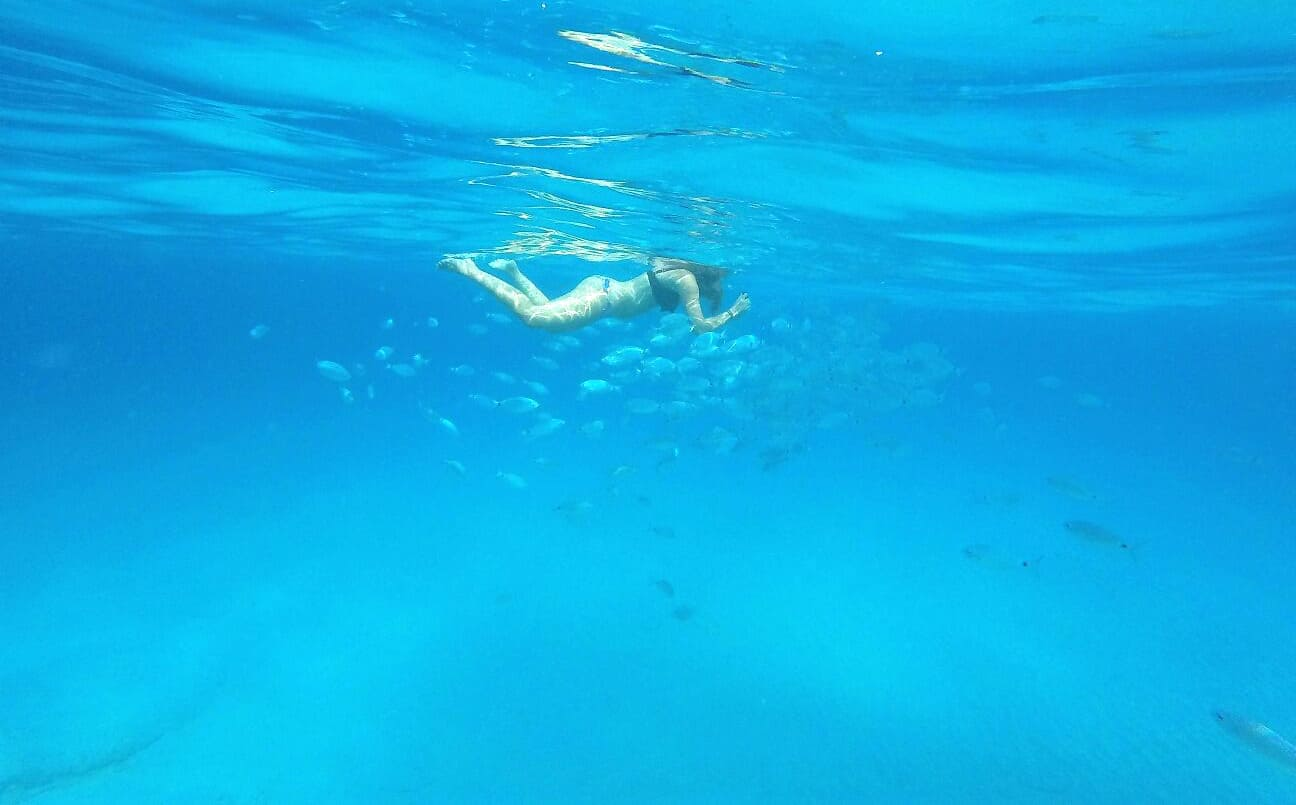 catamaran day charter Ibiza, girl snorkeling