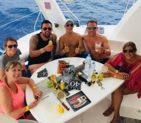 Guests having lunch on a catamaran