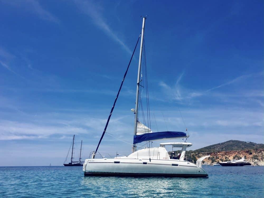 Catamaran Geronimo anchored in cala Tarida