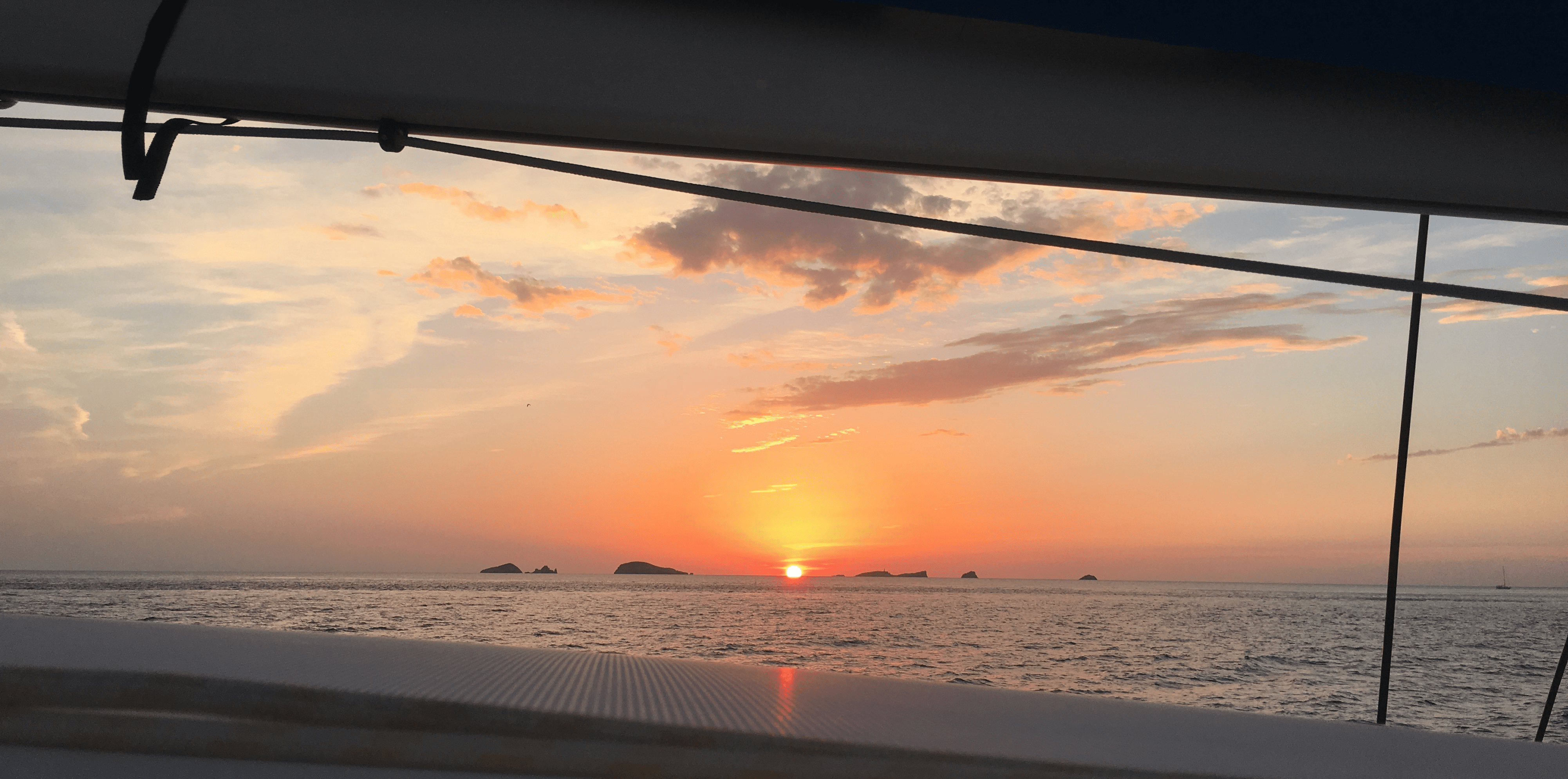 Catamaran day charter Ibiza, sunset from the catamaran