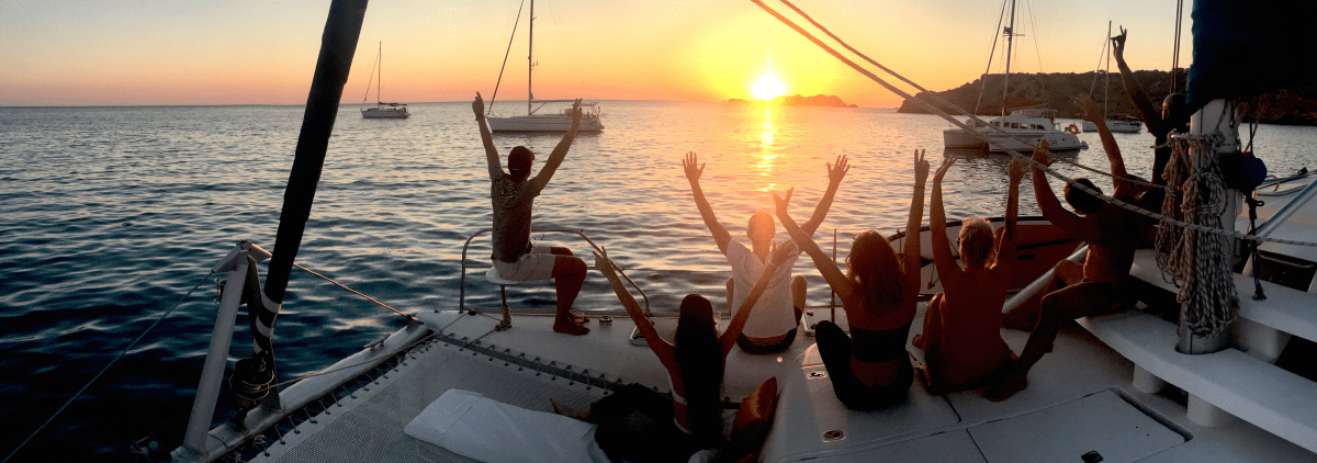 bachelorette party in Ibiza on catamaran, group enjoying the sunset