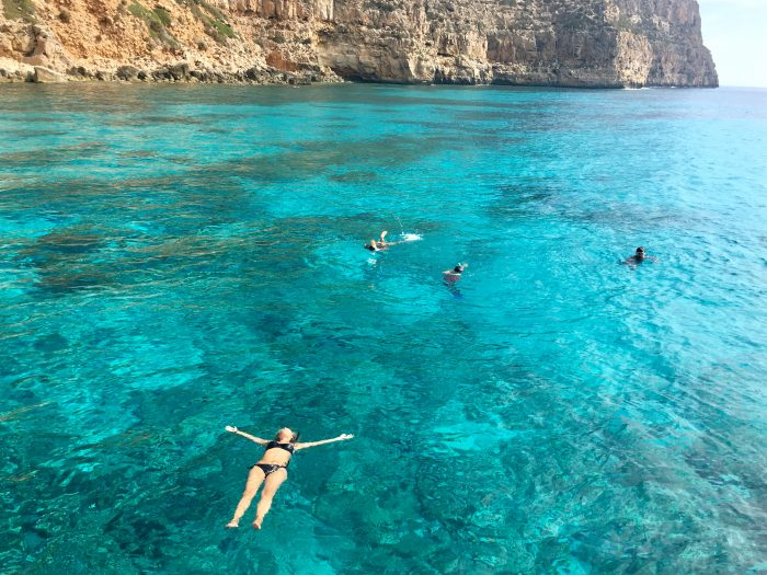 Family enjoying the crystal blue waters of Ibiza
