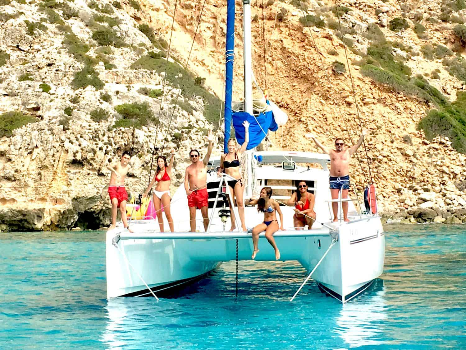 Family catamaran charter Ibiza - happy family on board