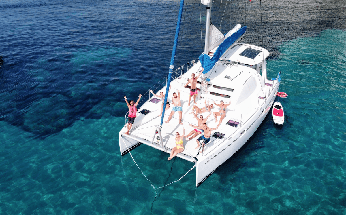Hen party on catamaran in Ibiza - the boat anchored in a beautiful cove